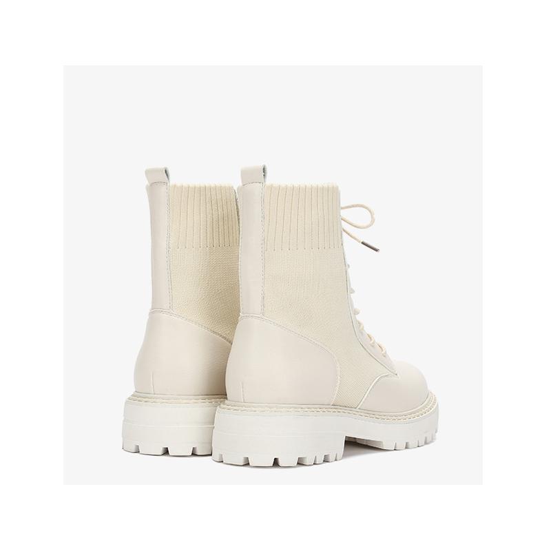 Daphne/达芙妮冬纯色圆头橡胶厚底时尚飞织中筒马丁袜靴